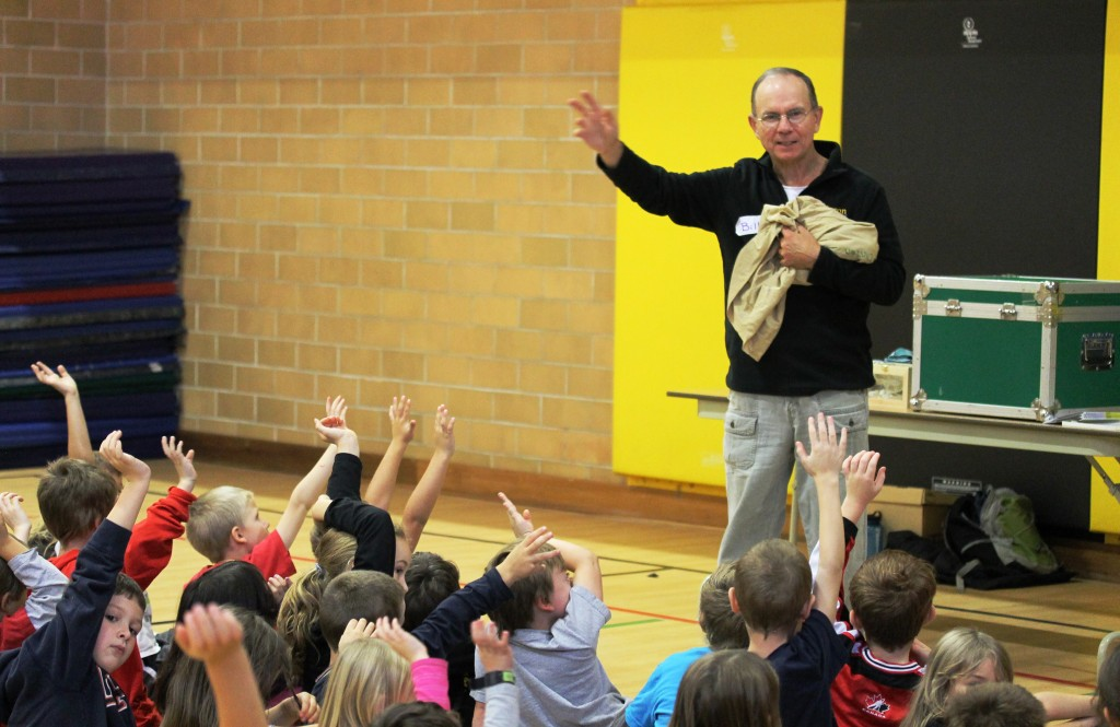 Bill asks the kids 'Who loves snakes and turtles?' before he reveals 4 Corn snakes.